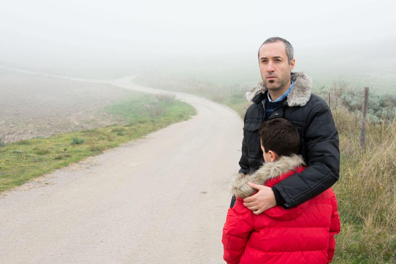 Bild zeigt: Vater und Sohn auf der Flucht